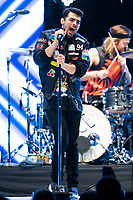 Vocalist Joe Jonas, drummer Jack Lawless, bassist Cole Whittle, and guitarist JinJoo Lee  of the band DNCE perform at the Bridgestone Arena on Tuesday, June 21, 2016. (Photo by Frederick Breedon)