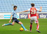 Coventry City's Sam Ricketts plays the ball forward under pressure from Fleetwood Town's Jack Sowerby<br /> <br /> Photographer Andrew Vaughan/CameraSport<br /> <br /> Football - The Football League Sky Bet League One - Coventry City v Fleetwood Town - Saturday 27th February 2016 - Ricoh Stadium - Coventry   <br /> <br /> © CameraSport - 43 Linden Ave. Countesthorpe. Leicester. England. LE8 5PG - Tel: +44 (0) 116 277 4147 - admin@camerasport.com - www.camerasport.com