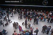 Passengers mingle at the Eurostar terminal at London's Waterloo Station in the 1990s before it was moved to St. Pancras, on 16th September 1996, in London, England.