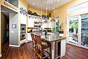 Kitchen Remodel with White Cabinets, Stainless Steel Appliances and Granite Countertops