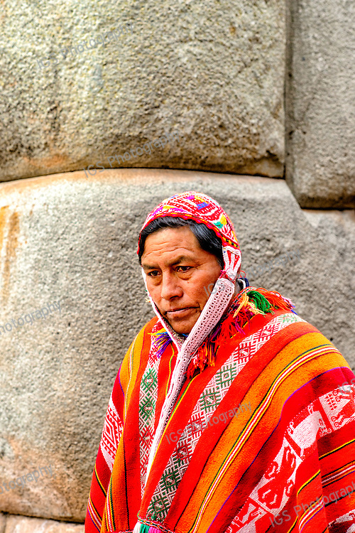 Quechua Indian  wearing traditional costume in the city of Cuzco in Cusco Province Peru South America