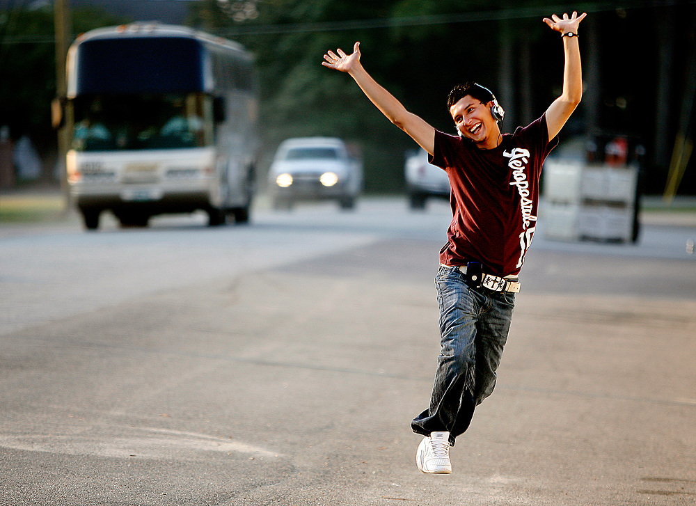 Gustavo Lara is overcome with joy as buses arrive to take the men back to their homes in Mexico.