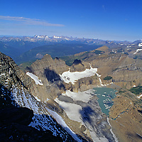 The Grinnell Glacier retreats above a lake it completely covered in 1938.