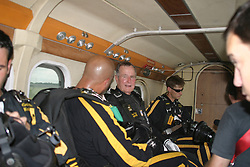 Former President George H.W. Bush talks with members of the United States Army Golden Knights Parachute Team in the aircraft as they prepare to jump from 13,000 feet at the Bush Presidential Library near Houston, Texas on June 13, 2004 to celebrate his his 80th birthday.<br /> Photo by US Army via CNP/ABACAPRESS.COM