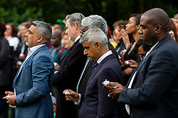 © Licensed to London News Pictures. 03/08/2021. LONDON, UK.  Sadiq Khan, Mayor of London, (C), and David Lammy, MP for Tottenham, (R), holding candles during a minute silence at a vigil at Barn Hill Pond, Fryent Country Park near Wembley to remember the lives of sisters Bibaa Henry and Nicole Smallman, on what would have been Nicole's 29th birthday.  The sisters were murdered in the park in June 2020 whilst celebrating Bibbaa's birthday.  Reclaim These Streets have worked with former Archdeacon of Southend, the Ven. Wilhelmina (Mina) Smallman, the late sisters' mother, to organise the vigil and attendees were encouraged to wear green and purple, the sisters' favourite colours, or light a candle.  Photo credit: Stephen Chung/LNP