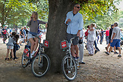 On the 100th anniversary of the Royal Air Force (RAF) and following a flypast of 100 aircraft formations representing Britain's air defence history which flew over central London, two members of the public gain extra height on Santander rental bikes, on 10th July 2018, in London, England.