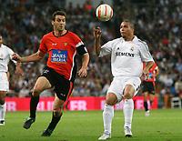 Real Madrid's Ronaldo in duel with Mallorca's Sergio Ballesteros during their Spanish league match at Santiago Bernabeu Stadium in Madrid, Sunday 02 October, 2005. (Photo / Alvaro Hernandez)<br /> <br /> Photo Graffiti