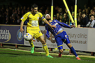 Sean Rigg of AFC Wimbledon® is intercepted by Seamus Conneely, the Accrington Stanley captain. Skybet football league two play off semi final, 1st leg match, AFC Wimbledon v Accrington Stanley at the Cherry Red Records Stadium in Kingston upon Thames, Surrey on Saturday 14th May 2016.<br /> pic by John Patrick Fletcher, Andrew Orchard sports photography.