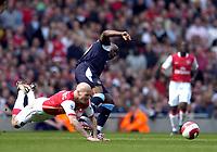 Photo: Olly Greenwood.<br />Arsenal v West Ham United. The Barclays Premiership. 07/04/2007. West Ham's Nigel Reo-Coker and Arsenal's Fredrik Ljungberg