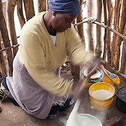 Venda woman cooking pap over a fire in Hamakuya. Venda village in Limpopo Province, South Africa.