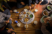 Rice farmer  Nguyen Van Theo's family enjoys a meal at their homestead in Tho Quang village, outside Hanoi. (Nguyen Van Theo is featured in the book What I Eat: Around the World in 80 Diets.)
