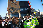 Thousands of school children went on strike and did not go to school demanding climate change action in central London March 15th 2019, Central London, United Kingdom. The strike is inspired by Greta Thunberg, a Swedish school girl who in 2018 went on school strike to make adults and lawmakers take climate change action.  A young women narrowly avoiding arrest after blocking the traffic in Parliament Square.
