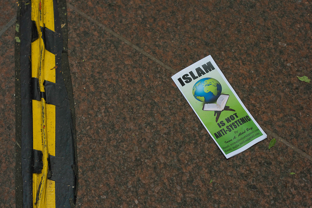 """An """"Islam is not Anti-Systemic"""" flyer lays on the floor of Zuccotti park where protesters have gathered for Occupy Wall Street movement. October 21, 2011"""