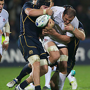 Mamuka Gorgodze, Georgia, is tackled by Ross Rennie, Scotland, (left) during the Scotland V Georgia Pool B match  during the IRB Rugby World Cup tournament.  Invercargill, New Zealand, 14th September 2011. Photo Tim Clayton..