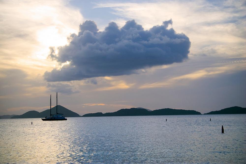 Large cloud over a sailboat in Honeymoon Bay, St. John, U.S. Virgin Islands, Caribbean