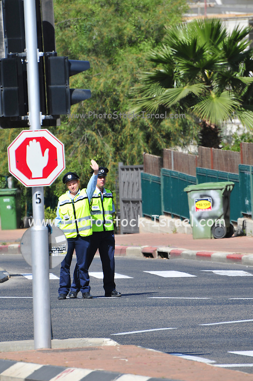 Israel, Traffic Cop directs traffic flow in an intersection