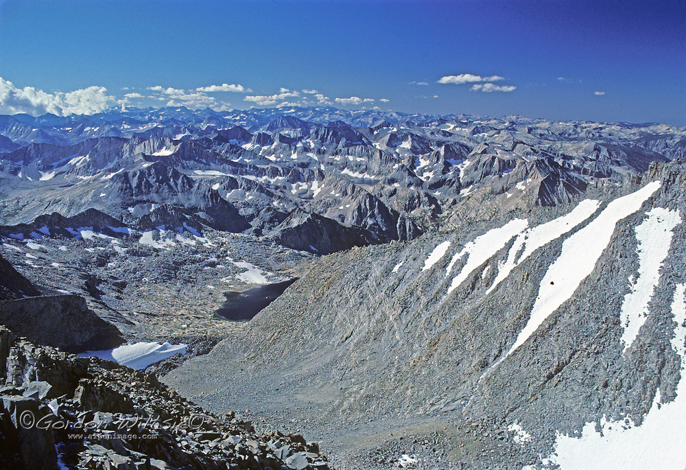 The summits, lakes and snowfields of Kings Canyon National Park spread below the summit of Mount Sill in the Palisades region of California's Sierra Nevada.