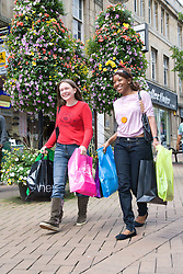 Young women out shopping together; Mansfield; Nottinghamshire,