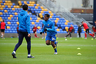 AFC Wimbledon attacker Zach Robinson (14) warming up prior to kick off during the EFL Sky Bet League 1 match between AFC Wimbledon and Sunderland at Plough Lane, London, United Kingdom on 16 January 2021.