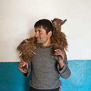 Nazarbek and goat. In Roshorv village.