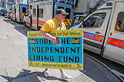 DPAC organise a protest outside the Department of Work and Pensions to demand that they save the Independent Living Fund. There is a heavy police presence in the background, after the Abbey closure at the weekend, but the liaison officers are very friendly. Westminster, London, UK 04 July 2014.