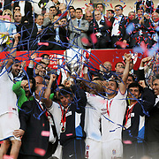 Jubilant Trabzonspor players Alan Carlos Gomes Da COSTA (L), Engin BAYTAR (2ndL), Rigobert Song BAHANAG (2ndR), Umut BULUT (R) lifting up the cup at the ceremony during their after the Turkey Cup final match Trabzonspor between Fenerbahce at the GAP Arena Stadium at Urfa Turkey on wednesday, 05 May 2010. Photo by TURKPIX
