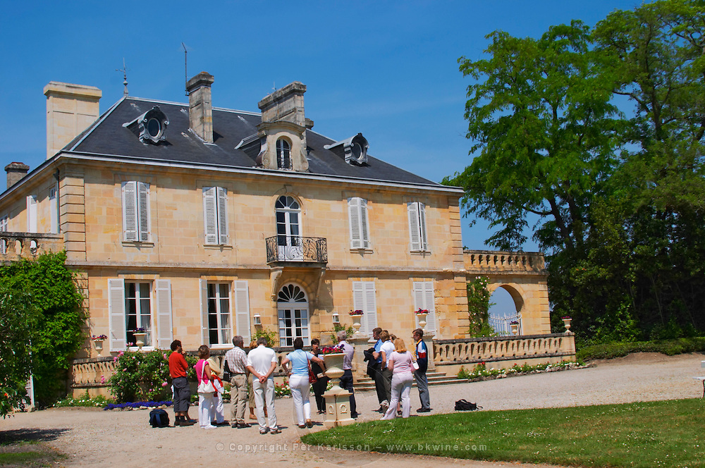 A group of visiting wine tasters in the garden in front of the chateau Kirwan, Cantenac Margaux Medoc Bordeaux Gironde Aquitaine France