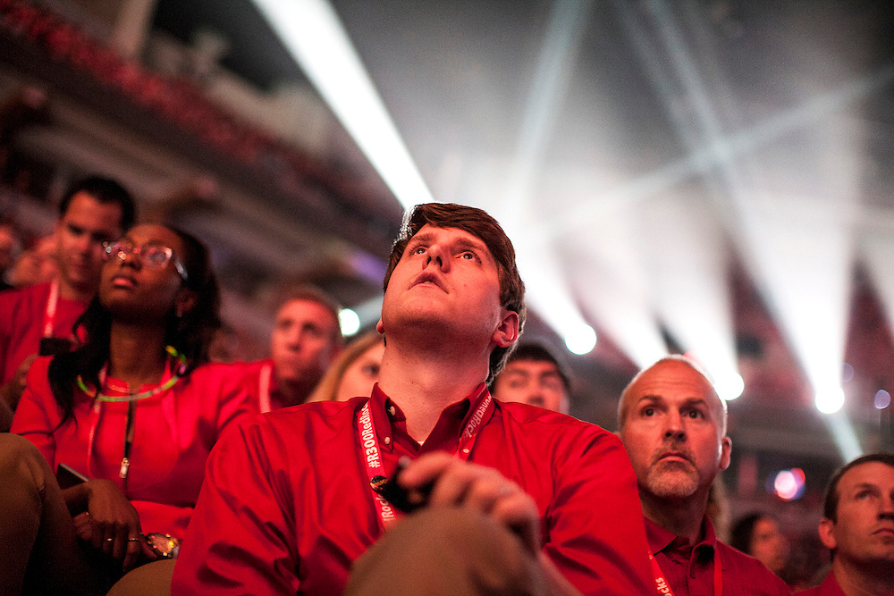 Brett Frasier of Alabaster, AL, listens to executive and celebrity speakers at the Target employee meeting at Target Center in Minneapolis September 10, 2014.