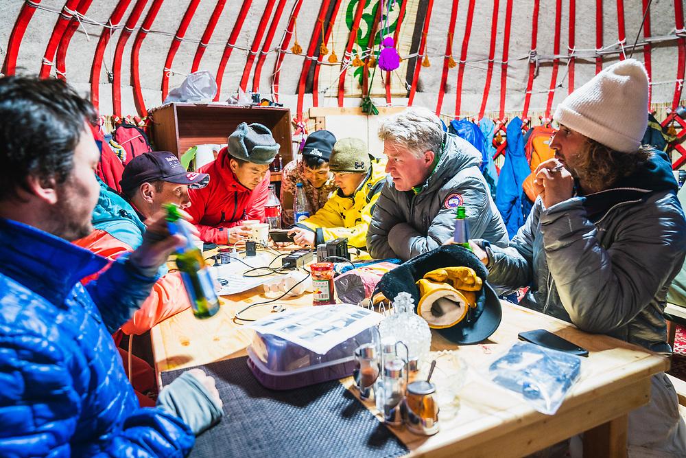 The organizers debrief at the Jyrgalan Yurt Camp - Day 3 Silk Road Freeride Competition, Jyrgalan, KG.