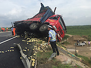 BINZHOU, CHINA - AUGUST 25: (CHINA OUT) <br /> <br /> A police officer stands in front of a damaged truck after the truck carrying tens of thousands of chicks, which are worth 50,000 yuan (7,800 USD), rolled over on Rongcheng-Wuhai Highwayin Binzhou, Shandong Province of China. <br /> ©Exclusivepix Media