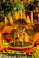 Performers on floats in the Carnaval parade of Unidos de Vila Isabel samba school in the Sambadrome, Rio de Janeiro, Brazil.