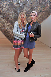 Left to right, ASTRID HARBORD and SUSANNA WARREN at an exhibition of photographic portraits by Bryan Adams entitled 'Hear The World' at The Saatchi Gallery, King's Road, London on 21st July 2009.