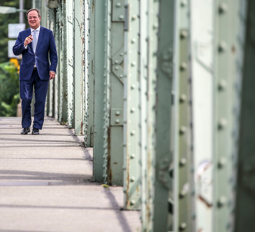 Party leader and Chancellor candidate of the Christian Democratic Union of Germany  (CDU), Armin Laschet walks on the Glienicker Brücke in Potsdam, Brandenburg, Germany August 13, 2021. Germany will hold its federal elections on September 26, 2021.