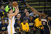 Golden State Warriors guard Klay Thompson (11) shoots a three pointer against the Indiana Pacers at Oracle Arena in Oakland, Calif., on December 5, 2016. Thompson scored 60 points in 3 quarters. (Stan Olszewski/Special to S.F. Examiner)