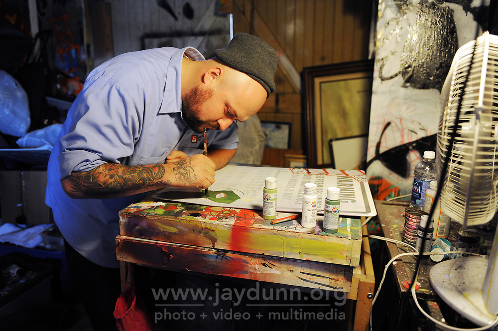 Salinas painter Liam Da Leo at work in his studio. His modern, edgy work, which incorporates graffiti themes, bold colors, and layered textures,  ranges freely across styles and sizes.