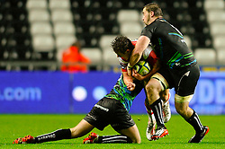 Gloucester Fly-Half (#10) Billy Burns is tackled by Ospreys Number 8 (#8) Morgan Allen picking up a shoulder injury in the process during the second half of the match - Photo mandatory by-line: Rogan Thomson/JMP - Tel: Mobile: 07966 386802 09/11/2012 - SPORT - RUGBY - Liberty Stadium - Swansea. Ospreys v Gloucester - LV= Cup