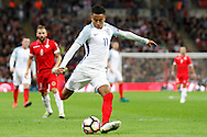 England Midfielder Jesse Lingard has a shot on goal during the FIFA World Cup Qualifier match between England and Malta at Wembley Stadium, London, England on 8 October 2016. Photo by Andy Walter.