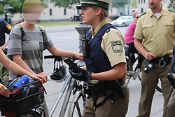 June 24, 2017 - Munich, Bavaria, Germany - Police officer confiscates mobile phone of a counter-protester (without legal reason)..Around 20 Christian fundamentalists demonstrated through Munich especially against abortion. (Credit Image: © Alexander Pohl/Pacific Press via ZUMA Wire)