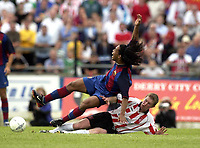 12 August 2003; Ronaldinho De Asis, Barcelona, in action against Derry City's Eamon Doherty. Friendly game, Derry City v Barcelona, Brandywell, Derry. Picture credit; David Maher / SPORTSFILE *EDI*