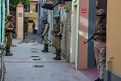 October 10, 2018 - Srinagar, Jammu & Kashmir, India - Indian Policemen seen standing on guard outside a deserted polling station in Srinagar during elections..Second phase of urban local body (ULB) Elections held in Jammu and Kashmir. Summer Capital of Indian controlled Kashmir, Srinagar. This had the lowest turnover of voters during the Local elections. (Credit Image: © Idrees Abbas/SOPA Images via ZUMA Wire)