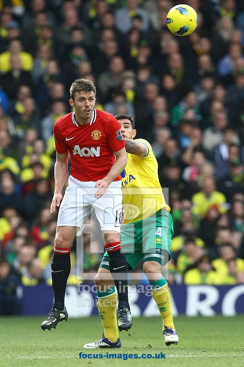 Picture by Paul Chesterton/Focus Images Ltd.  07904 640267.26/02/12.Bradley Johnson of Norwich and Michael Carrick of Man Utd in action during the Barclays Premier League match at Carrow Road Stadium, Norwich.