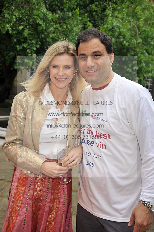 LORD & LADY BILIMORIA at the anual House of Lords vs House of Commons Tug of War in aid of Macmillan Cancer Support held in College Garden, Westminster Abbey, London on 9th June 2009.