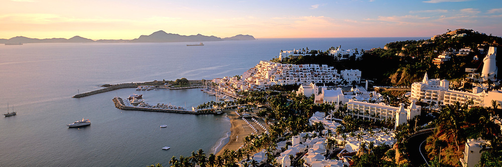 MEXICO, PACIFIC COAST, COLIMA STATE Manzanillo; the famous Las Hadas Resort in the foreground with the Bay of Manzanillo beyond