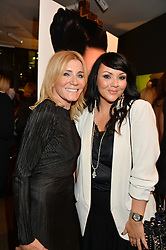 Left to right, MICHELLE COLLINS and MARTINE McCUTCHEON at the launch of Simply Glamorous by Gary Cockerill held at Alon Fine Art, 5-7 Dover Street, London on 16th September 2015.