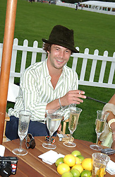 Musician JAY KAY at the 2004 Cartier International polo day at Guards Polo Club, Windsor Great Park, Berkshire on 25th July 2004.