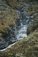 A group of rafters float through Mule Creek Canyon on the Rogue River, Oregon.