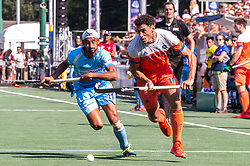 (L-R) Mandeep Singh of India, Glenn Schuurman of The Netherlands during the Champions Trophy match between the Netherlands and India on the fields of BH&BC Breda on June 30, 2018 in Breda, the Netherlands