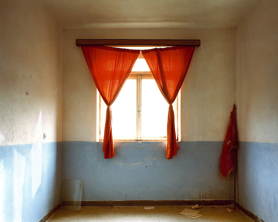 The office of the headmaster of the agricultural college of Grava. The only room with window glass  and curtains.