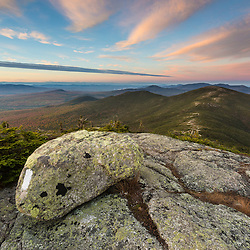 Sunset on the Appalachian Trail on Saddleback Mountain in Maine's High Peaks Region. The summit of The Horn is in the background.
