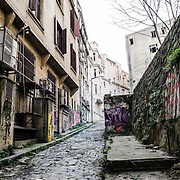 And old cobblestone allyway in the hilly Beyoglu district of Istanbul, Turkey.